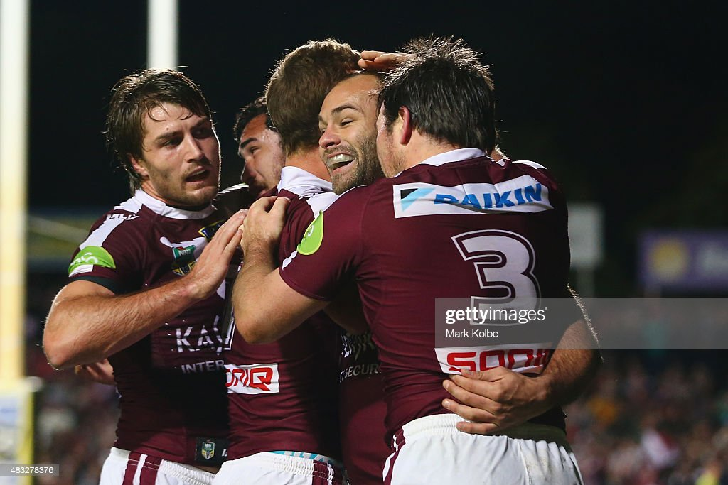 Kieran Foran,Peter Hiku, Daly Cherry-Evans, Brett Stewart and Jamie Lyon of the Eagles celebrate a try during the round 22 NRL match between the Manly Sea Eagles and the South Sydney Rabbitohs at Brookvale Oval on August 7, 2015 in Sydney, Australia.