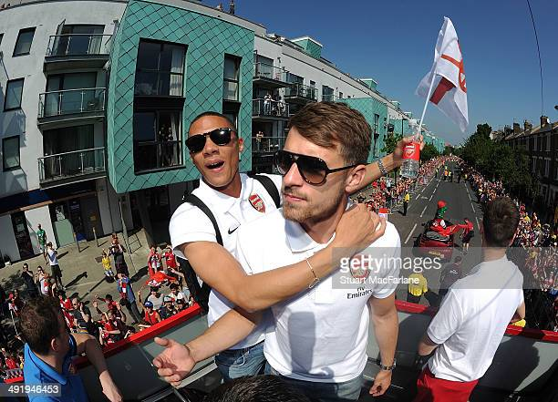 Kieran Gibbs and Aaron Ramsey pose at the Arsenal Victory Parade after winning the FA Cup Final on May 18 2014 in London England