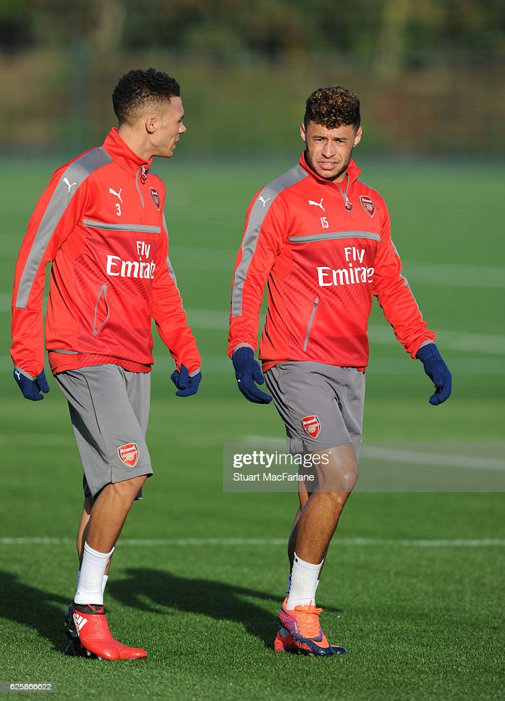 Kieran Gibbs and Alex Oxlade-Chamberlain of Arsenal before a training session in preparation for the Premier League match against AFC Bournemouth at London Colney on November 26, 2016 in St Albans, England.