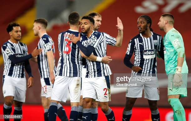 Kieran Gibbs and Darnell Furlong of West Bromwich Albion embrace after the Premier League match between Liverpool and West Bromwich Albion at Anfield...
