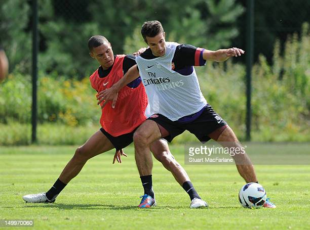 Kieran Gibbs and Robin van Persie of Arsenal during a training session at the Arsenal training camp on August 8 2012 in Hennef Germany