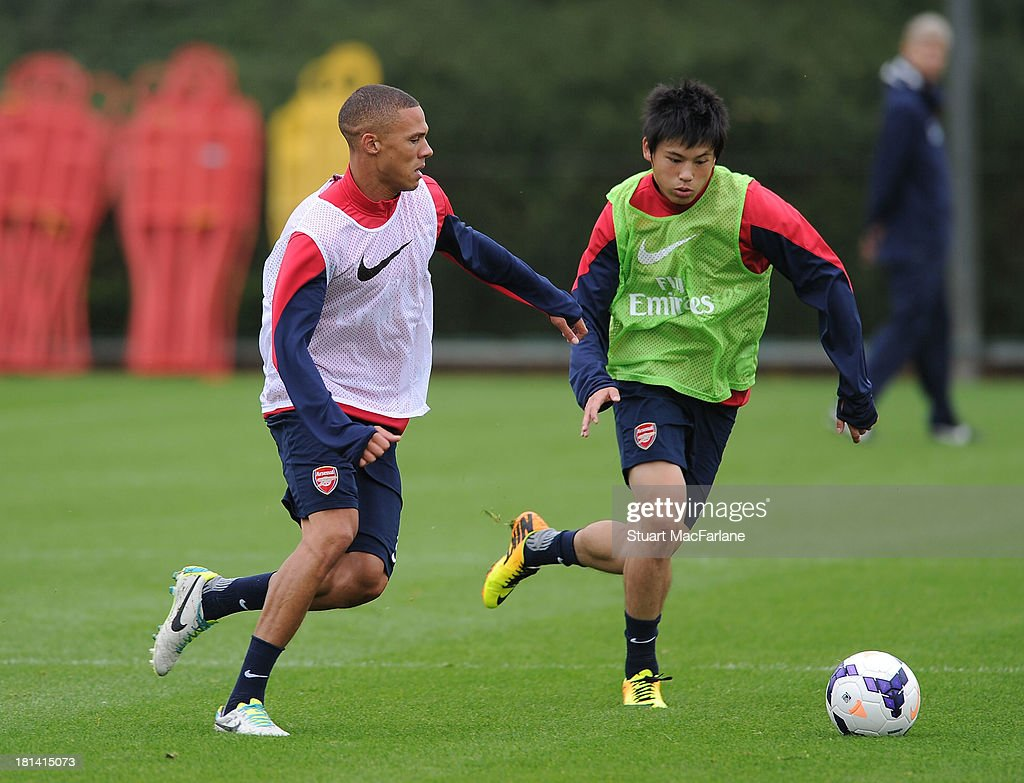 Kieran Gibbs and Ryo Miyaichi of Arsenal during a training session at London Colney on September 21, 2013 in St Albans, England.