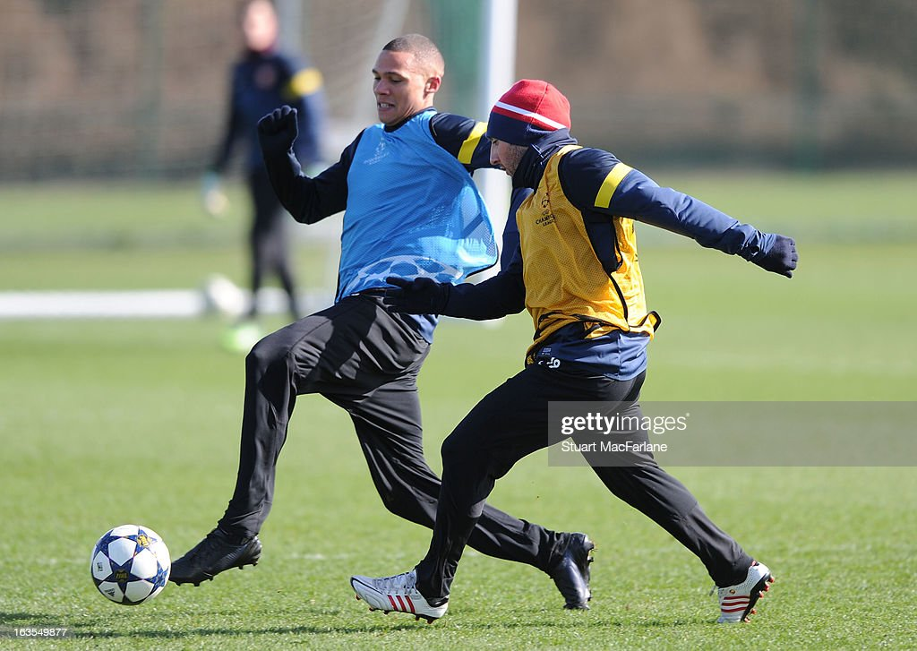 Kieran Gibbs and Santi Cazorla of Arsenal during a training session at London Colney on March 12, 2013 in St Albans, England.