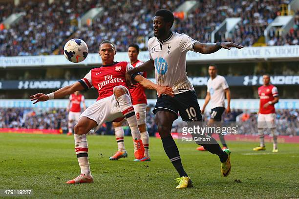 Kieran Gibbs of Arsenal and Emmanuel Adebayor of Tottenham Hotspur battle for the ball during the Barclays Premier League match between Tottenham...