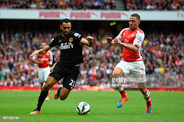Kieran Gibbs of Arsenal battles for the ball with Ahmed Elmohamady of Hull City during the Barclays Premier League match between Arsenal and Hull...