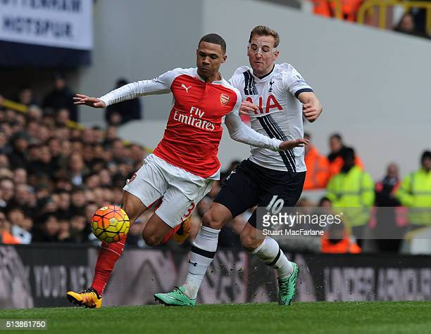 Kieran Gibbs of Arsenal breaks past Harry Kane of Tottenham during the Barclays Premier League match between Tottenham Hotspur and Arsenal at White...