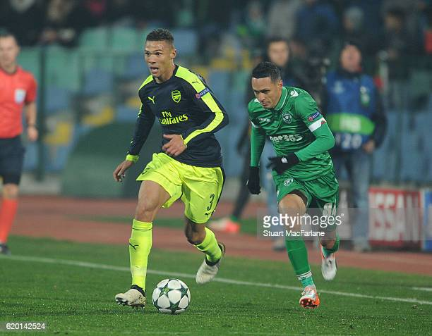 Kieran Gibbs of Arsenal breaks past Marcelinho of Ludogorets during the UEFA Champions League match between PFC Ludogorets Razgrad and Arsenal FC at...