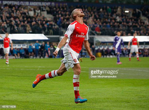Kieran Gibbs of Arsenal celebrates as he scores their first and equalising goal during the UEFA Champions League Group D match between RSC Anderlecht...
