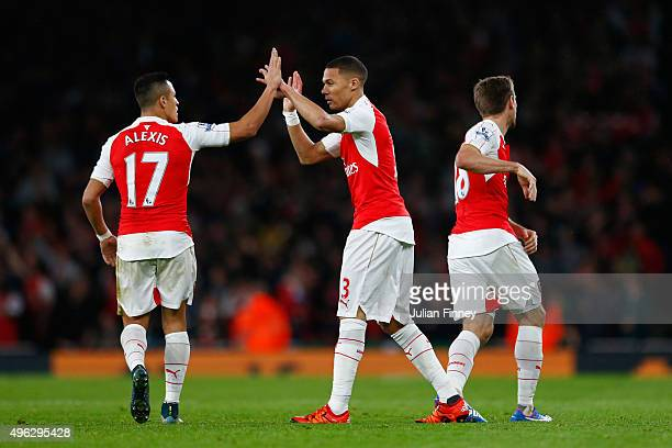 Kieran Gibbs of Arsenal celebrates with Alexis Sanchez of Arsenal after scoring his side's first goal during the Barclays Premier League match...