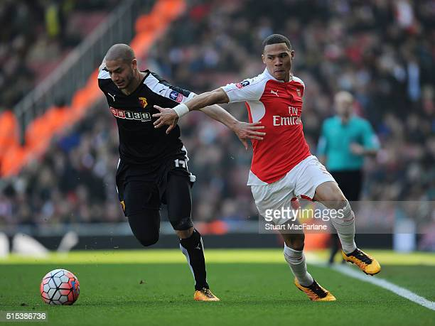 Kieran Gibbs of Arsenal challenged by Adlene Guedioura of Watford during the Emirates FA Cup Sixth Round match between Arsenal and Watford at...