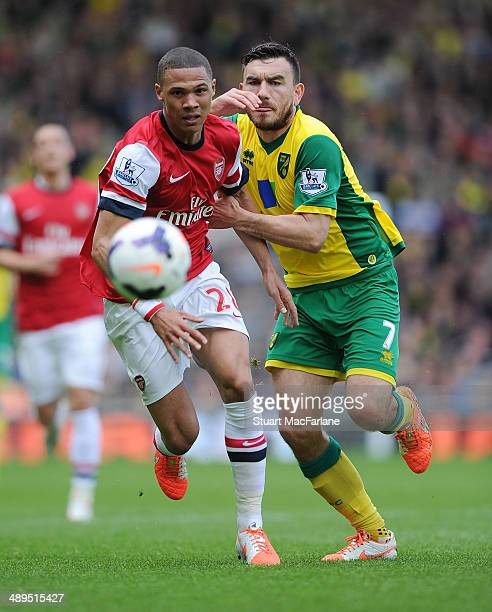 Kieran Gibbs of Arsenal challenged by Robert Snodgrass of Norwich during the Barclays Premier League match between Norwich City and Arsenal at Carrow...