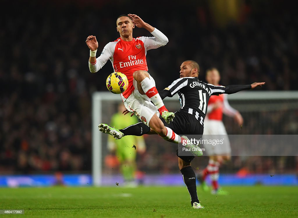 Kieran Gibbs of Arsenal challenges for the ball with Yoan Gouffran of Newcastle United during the Barclays Premier League match between Arsenal and Newcastle United at Emirates Stadium on December 13, 2014 in London, England.