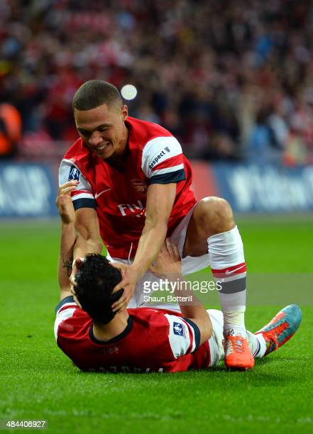 Kieran Gibbs of Arsenal congratulates Santi Cazorla of Arsenal on scoring the winning penalty during the FA Cup SemiFinal match between Wigan...
