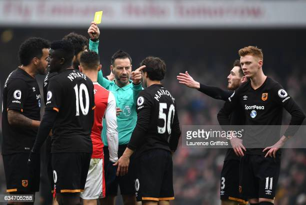 Kieran Gibbs of Arsenal is shown a yellow card by referee Mark Clattenburg during the Premier League match between Arsenal and Hull City at Emirates...