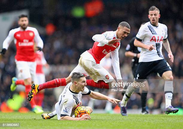 Kieran Gibbs of Arsenal is tackled by Kevin Wimmer of Tottenham Hotspur during the Barclays Premier League match between Tottenham Hotspur and...