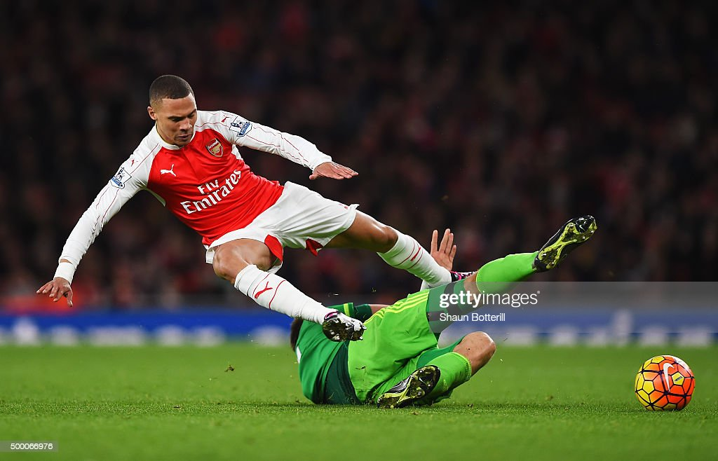 Kieran Gibbs of Arsenal is tackled by Sebastian Coates of Sunderland during the Barclays Premier League match between Arsenal and Sunderland at Emirates Stadiumon December 5, 2015 in London, England.