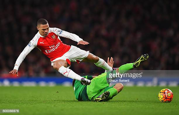 Kieran Gibbs of Arsenal is tackled by Sebastian Coates of Sunderland during the Barclays Premier League match between Arsenal and Sunderland at...