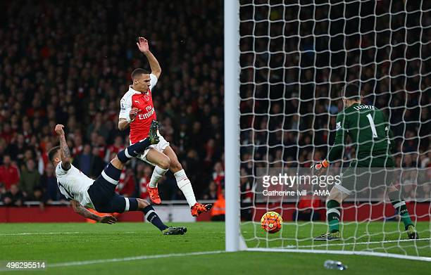 Kieran Gibbs of Arsenal scores a goal to make it 11 during the Barclays Premier League match between Arsenal and Tottenham Hotspur at Emirates...