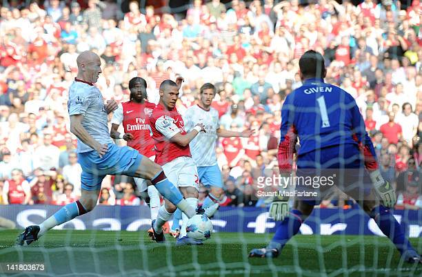 Kieran Gibbs of Arsenal shoots past goalkeeper Shay Given of Aston Villa to score the first goal during the Barclays Premier League match between...