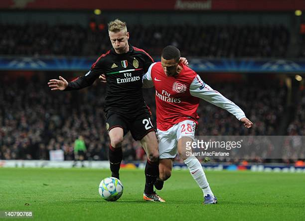 Kieran Gibbs of Arsenal takes on AC Milan defender Ignazio Abete during the UEFA Champions League Round of 16 match between Arsenal FC and AC Milan...