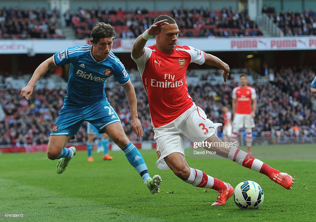 Kieran Gibbs of Arsenal takes on Billy Jones of Sunderland during the match between Arsenal and Sunderland in the Barclays Premier League at Emirates Stadium on May 20, 2015 in London, England.