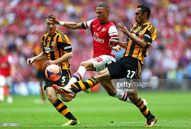 Kieran Gibbs of Arsenal takes on James Chester and Ahmed Elmohamady of Hull City during the FA Cup with Budweiser Final match between Arsenal and...