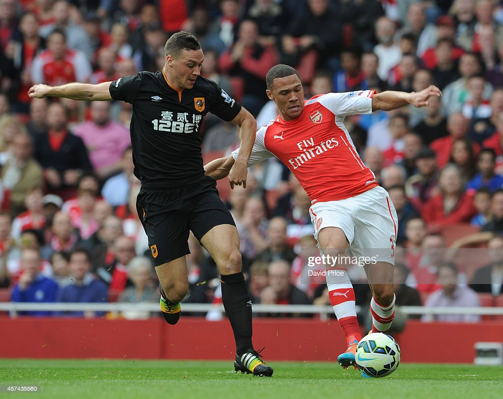 Kieran Gibbs of Arsenal takes on James Chester of Hull during the match between Arsenal and Hull City in the Barclays Premier League at Emirates Stadium on October 18, 2014 in London, England.