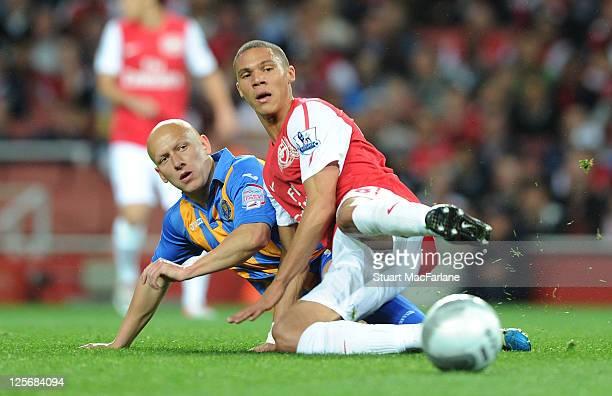 Kieran Gibbs of Arsenal takes on Matthew Richards of Shrewsbury during the Carling Cup Third Round match between Arsenal and Shrewsbury Town at...