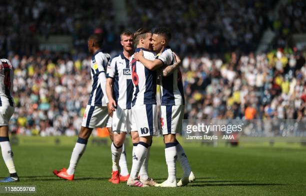 Kieran Gibbs of West Bromwich Albion celebrates with his team mates after scoring a goal to make it 1-0 during the Sky Bet Championship match between...
