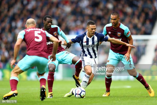 Kieran Gibbs of West Bromwich Albion is challenged by Winston Reid of West Ham United and Cheikhou Kouyate of West Ham United during the Premier...