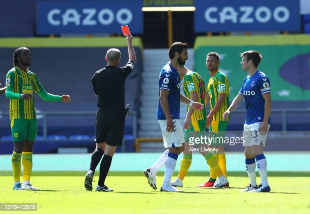 Kieran Gibbs of West Bromwich Albion is shown the red card by Match Referee Mike Dean during the Premier League match between Everton and West...