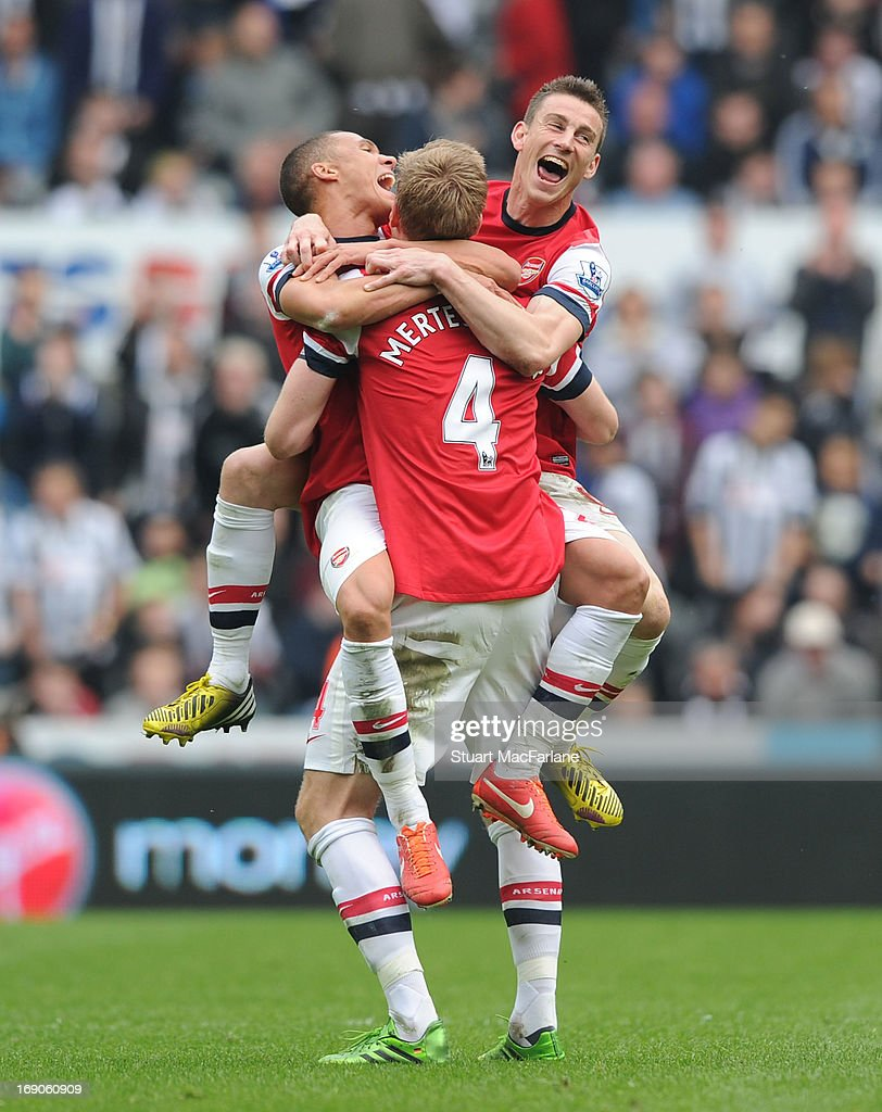 Kieran Gibbs, Per Mertesacker and Laurent Koscielny celebrate celebrate the Arsenal victory after the Barclays Premier League match between Newcastle United and Arsenal at St James' Park on May 19, 2013 in Newcastle upon Tyne, England.