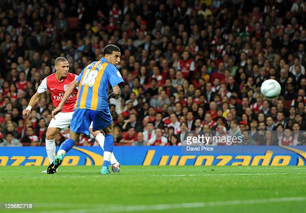 Kieran Gibbs scores Arsenal's first goal during the Carling Cup Third Round match between Arsenal and Shrewsbury Town at Emirates Stadium on...