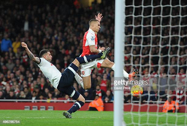 Kieran Gibbs scores Arsenal's goal under pressure from Kyle Walker of Tottenham during the Barclays Premier League match between Arsenal and...