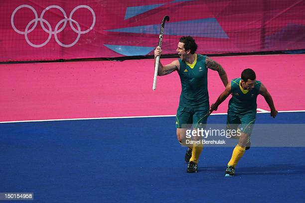 Kieran Govers of Australia celebrates with team mates after scoring his team's third goal during the Men's Hockey bronze medal match on Day 15 of the...