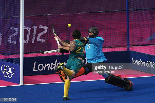 Kieran Govers of Australia scores his team's third goal against James Fair of Great Britain during the Men's Hockey bronze medal match on Day 15 of...
