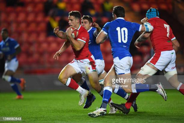 Kieran Hardy of Wales runs in to score their first try during the Autumn Nations Cup match between Wales and Italy at Parc y Scarlets on December 05,...