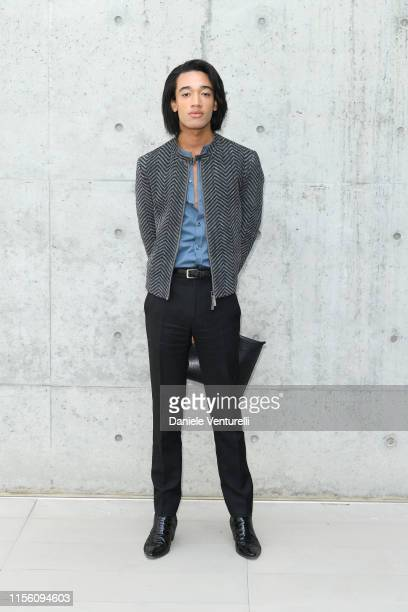 Kieran J Reilly arrives at the Emporio Armani fashion show during the Milan Men's Fashion Week Spring/Summer 2020 on June 15 2019 in Milan Italy