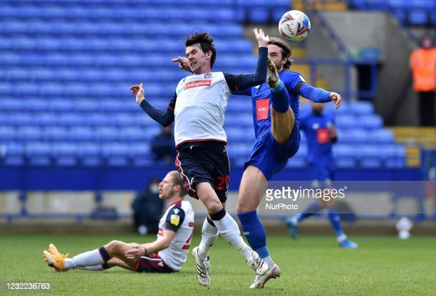 Kieran Lee of Bolton Wanderers tussles with Dan Jones of Harrogate Town during the Sky Bet League 2 match between Bolton Wanderers and Harrogate Town...