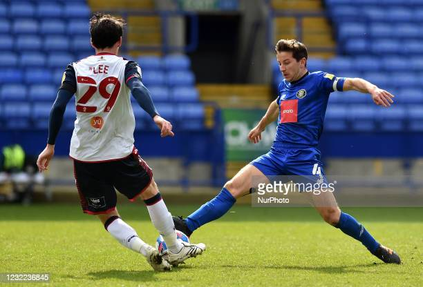 Kieran Lee of Bolton Wanderers tussles with Josh Falkingham of Harrogate Town during the Sky Bet League 2 match between Bolton Wanderers and...