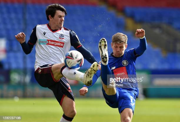 Kieran Lee of Bolton Wanderers tussles with Lloyd Kerry of Harrogate Town during the Sky Bet League 2 match between Bolton Wanderers and Harrogate...