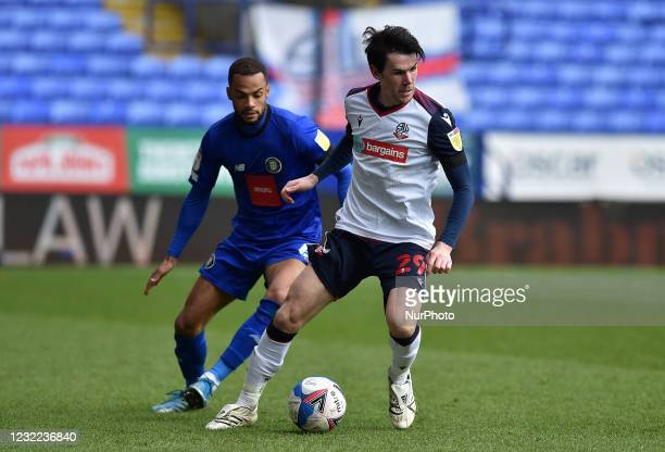 Kieran Lee of Bolton Wanderers tussles with Warren Burrell of Harrogate Town during the Sky Bet League 2 match between Bolton Wanderers and Harrogate...