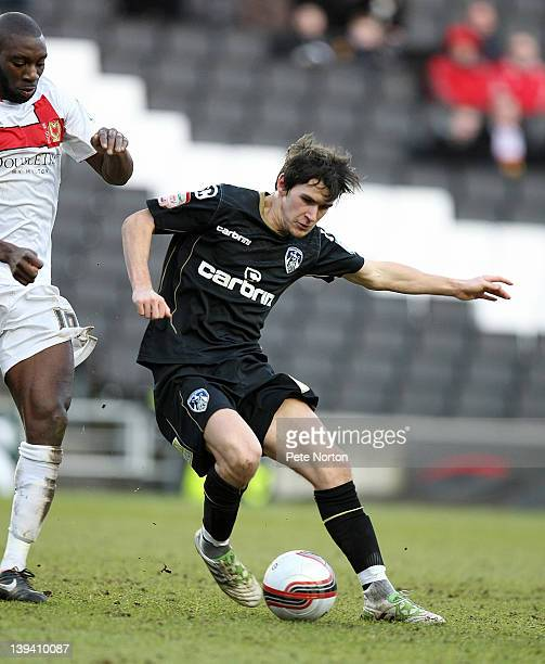 Kieran Lee of Oldham Athletic looks to play the ball under pressure from Jabo Ibehre of MK Dons during the npower League One match between MK Dons...