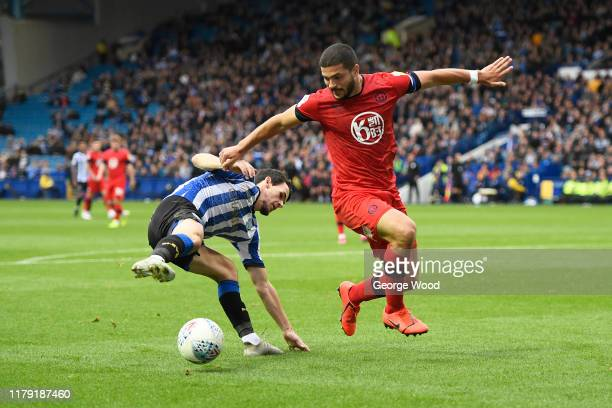 Kieran Lee of Sheffield Wednesday battles for the ball with Sam Morsy of Wigan Athletic during the Sky Bet Championship match between Sheffield...