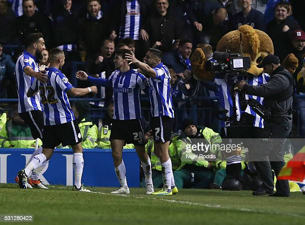 Kieran Lee of Sheffield Wednesday celebrates scoring with teamates during the Sky Bet Championship Play Off First Leg between Sheffield Wednesday and...