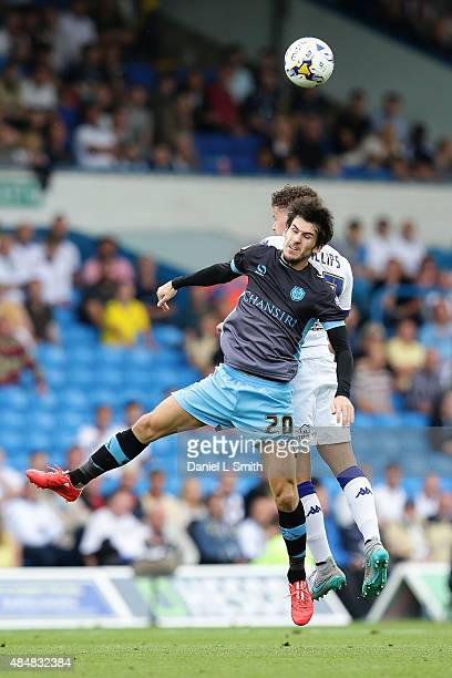 Kieran Lee of Sheffield Wednesday FC and Kalvin Phillips of Leeds United FC head the ball during the Sky Bet Championship match between Leeds United...