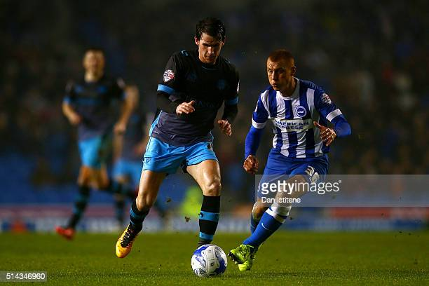 Kieran Lee of Sheffield Wednesday runs with the ball under pressure from Steve Sidwell of Brighton and Hove Albion of during the Sky Bet Championship...