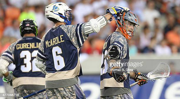 Kieran McArdle celebrates Drew Snider of the Cowboys goal against the Gladiators in the second half during the 2015 MLL All Star Game on June 13 2015...