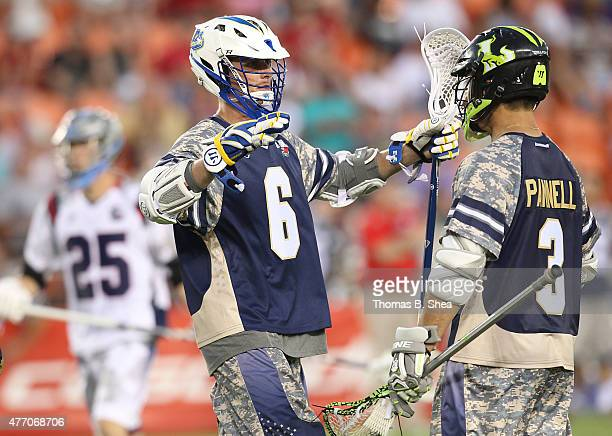 Kieran McArdle celebrates his goal with Rob Pannell of the Cowboys against the Gladiators in the second half during the 2015 MLL All Star Game on...