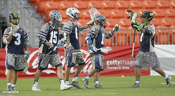 Kieran McArdle of the Cowboys celebrates his goal with teammates against the Gladiators in the second half during the 2015 MLL All Star Game on June...
